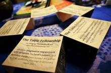 "Sticky notes with ""The Table Fellowship"" displayed in a circle, on a indigo table cloth"